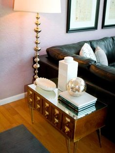 This side table brings together many elements and styles.  Retro metal legs were attached to an old library card catalog cabinet, then a mirror was placed on top for a little glamorous flair.