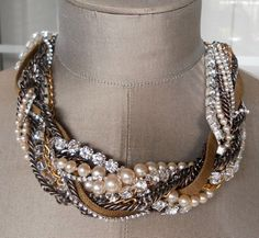 $125.00 take several necklaces or strands of chain rhinestones etc. and weave them together to create a gorgeous chunky choker like this <3  would be a great wedding look with a strapless dress