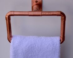 Copper Hand Towel RingIndustrial Steampunk Home Decor for that trending, contemporary style!Perfect for the bathroom or x x 3 copper pipe with copper mounting plateEasily installed with two recessed screws that are included Towel Rod, Towel Hooks, Towel Holder, Copper Bathroom, Copper Kitchen, Bathroom Fixtures, Steampunk Home Decor, Towel Rack Bathroom, Rustic Mason Jars