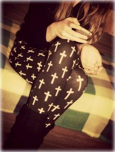 Crosses crosses crosses i think with a black skirt that reach to the knees over these leggings, would be cute and modest