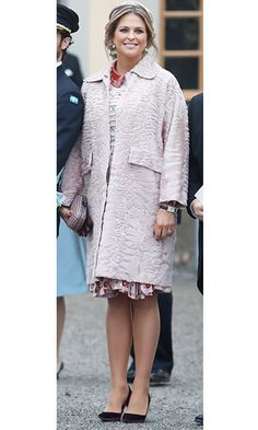 Serving as godmother to her nephew Prince Gabriel at the baby's royal christening, Princess Madeleine of Sweden wore a soft pink dress by Valentino along with a dusty rose coat and box clutch.   Photo: © Getty Images