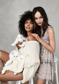 The December 2016 catalog from Free People fully embraces sweater weather. Models Luma Grothe and Cora Emmanuel appear in an editorial called, 'Current Mood: Smitten'. Photographed by Bjorn Iooss, the pair pose in cozy looks including oversized sweaters, velvet joggers and one-pieces. Luma and Cora pose alongside cute kittens in the fashion shoot. Paired with …