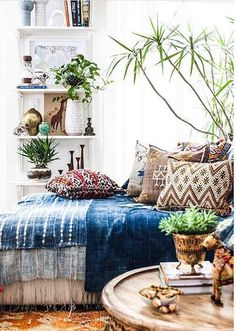 Layered textiles, lots of greenery and great styling gives a modern boho feel to this room.