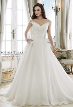 Courtesy of Sophia Tolli wedding dresses from Mon Cheri Bridals; Wedding dress idea.
