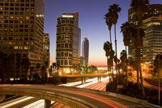 Los Angeles, California State Route 110, Ritz-Carlton Hotel, Wedbush Tower, City lit up at dusk