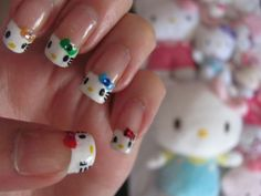 Hello Kitty nails,bliss would love it if I did this. How ever I don't think I could pull these off.....cute idea though!