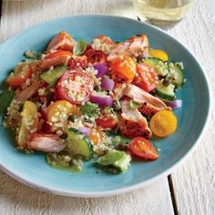 Cooking the salmon with the skin on keeps the flesh silky and tender and bastes it with its own healthy fat. We love using a variety of heirloom cherry tomatoes--scout your farmers' market for the best options.