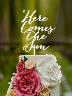"Beatles Wedding Cake Topper feat. ""Here Comes the Sun"" http://emmalinebride.com/reception/beatles-wedding-cake-topper/"
