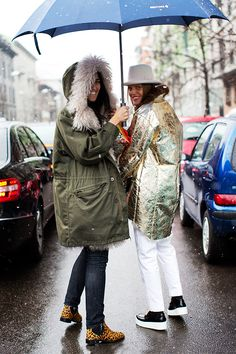 At Etro....Under the umbrella is where it all happens for this pair. Por ejemplo?Metallic topper, fabulous creepers, and leopard booties. Pay that. #TheSartorialist.
