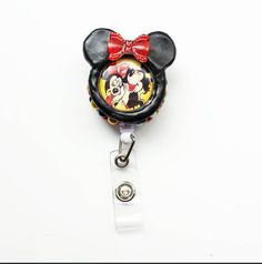 Check out this item in my Etsy shop https://www.etsy.com/listing/207916831/decorated-badge-reel-mickey-minnie-mouse