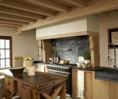 Antique work table, soapstone, and Lacanche stove; Melanie Pounds