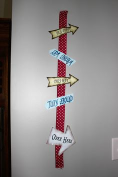 Alice in Wonderland theme.  Took red polka dot ribbon and printed arrows out from internet.