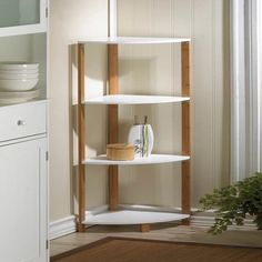 Bamboo Corner Shelf Sleek bamboo and wood corner unit can be used for organizing or displaying just about anything. Four white shelves and a bamboo frame. Bamboo and MDF wood. Corner Shelf Design, Corner Shelving Unit, Corner Bookshelves, Corner Unit, Display Shelves, Wall Shelves, Wood Display, Wood Shelf, Regal Display