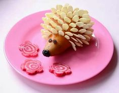 Hedgehog!  Pear, almonds, raisins and radishes! Fun!