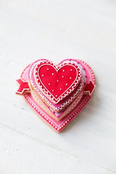 More gorgeous Valentine's Day cookies covered with red and pink royal icing. #valentine #holiday #pink #baking #dessert #pretty
