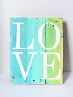 This beautiful reclaimed wood pallet sign is about 12 inches tall by 10 inches wide. Hand painted, with a blue ombré background and white
