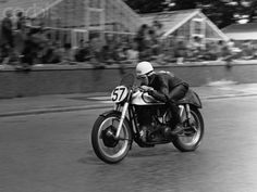 British motorcyclist Geoff Duke races on a Norton bike in the Tourist Trophy Races, Isle of Man 1950