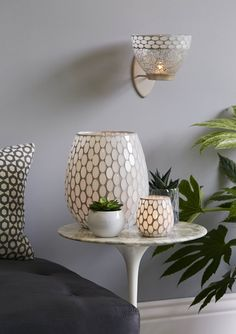 This was MY MUST HAVE - I put it in my entryway/foyer and I love it!  Champagne Glow collection with hurricane, warmer, tealight holder and wall sconce! Shop at partylite.biz/FlaminFiasco