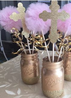 This is Made with a mason jar bottom with a glitter and a cross made out of glitter card stock and 2 tulle Pom poms. If you would like different colors just message me about it
