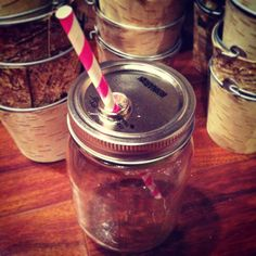 DIY Mason Jar to-go cup! Super easy to make & cute too! Used two 1/4 washers from Home Depot, a nail & hammer, hot glue, & a striped straw... This one is just a pink paper straw, I also have a red & white one & green TALL size from Starbucks that fits perfectly! -k