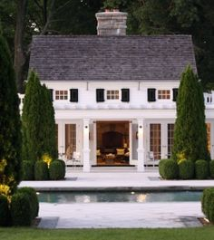 This cottage seems so perfectly quaint. New England somewhere, the pool is a fantastic bonus. I love those windows!