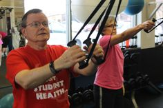 Gerry and Jane Kennedy exercise on the cable machine at the north Ames Racquet and Fitness Center on Wednesday Jan. 13, 2016. Photo by Grayson Schmidt/Ames Tribune  http://amestrib.com/news/resolution-23-years-and-counting