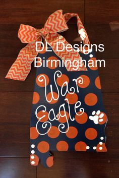 Auburn door hanger in navy and orange. Perfect for any Auburn fan! Includes chevron burlap with bow for hanging and a paw print right over