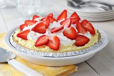 An airy lemon pudding and cream cheese filling is spooned into a shortbread crust and topped with fresh strawberry slices in this luscious pie.