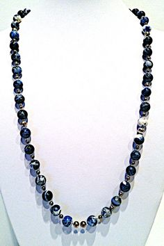 Beautiful denim lapis beads are accented with sterling silver round beads and crystal glass seed beads. 29 long necklace is a beautiful, elegant