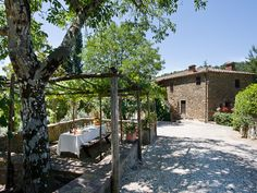Cottage Alexa  Radda in Chianti, Siena, Italy    The vine covered pergola furnished for al fresco dining is equipped with a barbecue and overlooks an idyllic olive grove.