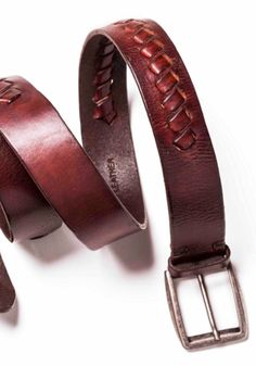 Leather belt detail. Travelled. Iter Itineris. Designed in Italy.