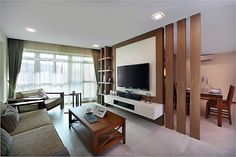 Here is another stunning divider which is adding to the utility at home. The divider is separating the dining area from that of the living room or TV lounge. The divider here is also serving as the wooden media cabinet and shelf. The vertical wooden columns with empty spaces are giving a feeling of openness.