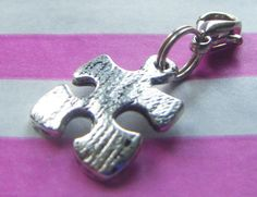 Clip on jigsaw puzzle charm. If there are charms to add to the bracelet, this kind of clip could make it easier for the children to pin on themselves. (BeeHootie, 2014)