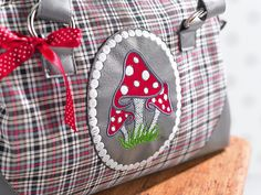 great idea for a handbag  - using my embroidery machine patch applique