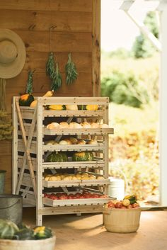 """Orchard Rack   Buy from Gardener's Supply  Years ago, people stored """"keeper"""" crops such as apples, winter squash, onions and potatoes on rustic wooden racks like this one. The drawers are slatted to ensure good air circulation, and they slide out for easy access."""