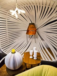 """Brooks created an """"eggshell"""" made from wooden slats to be a centerpiece of this experimental space. A copper chair mouted in the center is an eye-catching focal point. """"This is one of the finest sculptural pieces we've seen on the show,"""" said judge Genevieve Gorder."""