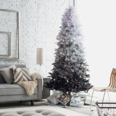 vintage inspired white to black Christmas tree with lights looks very chic