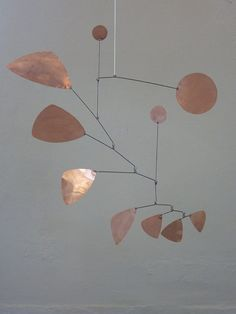 Beautiful floating freely mobile made of copper. Hand-made. High-quality. 0, 3mm copper. 70 x 70cm Copper and iron. Each mobile is produced