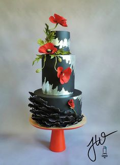 Gum paste flowers, silver leaf in a not so traditional application, and fondant poppy petal ruffles. -Jeanne Winslow Cake Design