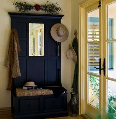 blue color for our front door... I like the yellow paint on door and trim... blue & yellow... Blue hall tree... Blue bench... yellow french doors... Blue and yellow..