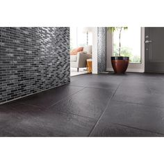 Black Gemstone Mosaic tile. Available at Lowe's.