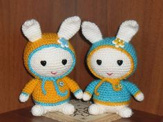 White hare in blue yelow jacket ukrainian colors. by MargoToys