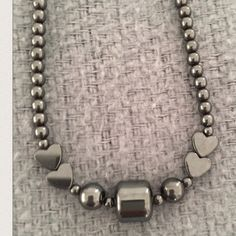 🗝💟 Vintage Handmade Hematite Necklace Handmade hematite beaded necklace. Metallic gray. Screw cap closure. A fun, stylish addition to dress up or add flare to an outfit! About 7 1/2 inches in length. Jewelry Necklaces