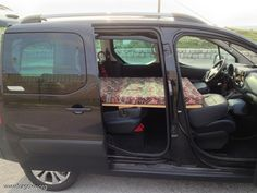 Good idea in this pic- Using the folded down passenger seat as extra bed length.