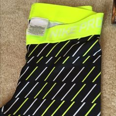 Brand New Nike Dri-Fit Stay Cool Pants Never worn - size Medium, full length Dri-Fit pant with neon yellow elastic band. Black with neon yellow and white. Fitted ankle. Nike Pants Track Pants & Joggers