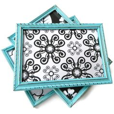 aqua+black+white! Small frames that are painted and antiqued with different black and white prints inside!