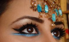 This is excellent! Gold and blue shadow w/ bold lashes and a whole lotta eyeliner! YES.