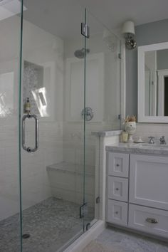 Built in shower bench under the shower head. with door on other side. Our door would open either direction.     bathroom \\ shower with bench + nook. nice combo of subway + penny tiles plus granite. half way between shower + vanity. notice subway tile continues from shower to sink backsplash...