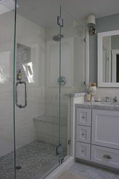 bathroom \\ shower with bench + nook. nice combo of subway + penny tiles plus granite. half way between shower + vanity. notice subway tile continues from shower to sink backsplash...