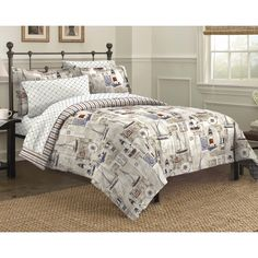 The comforter set features a nautical theme of sailboats and lighthouses and reverses to a multicolored stripe pattern.